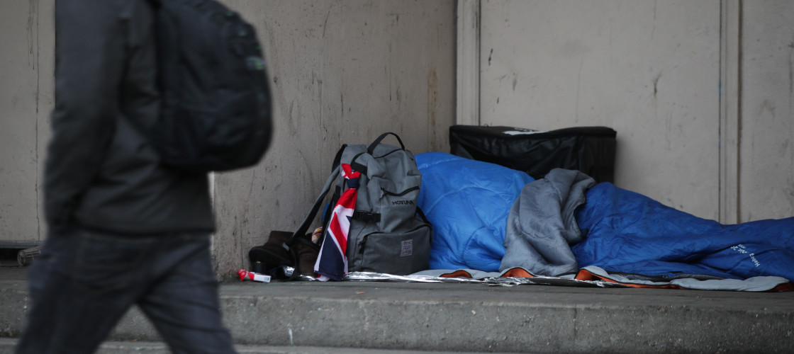 A homeless person beds down in central London