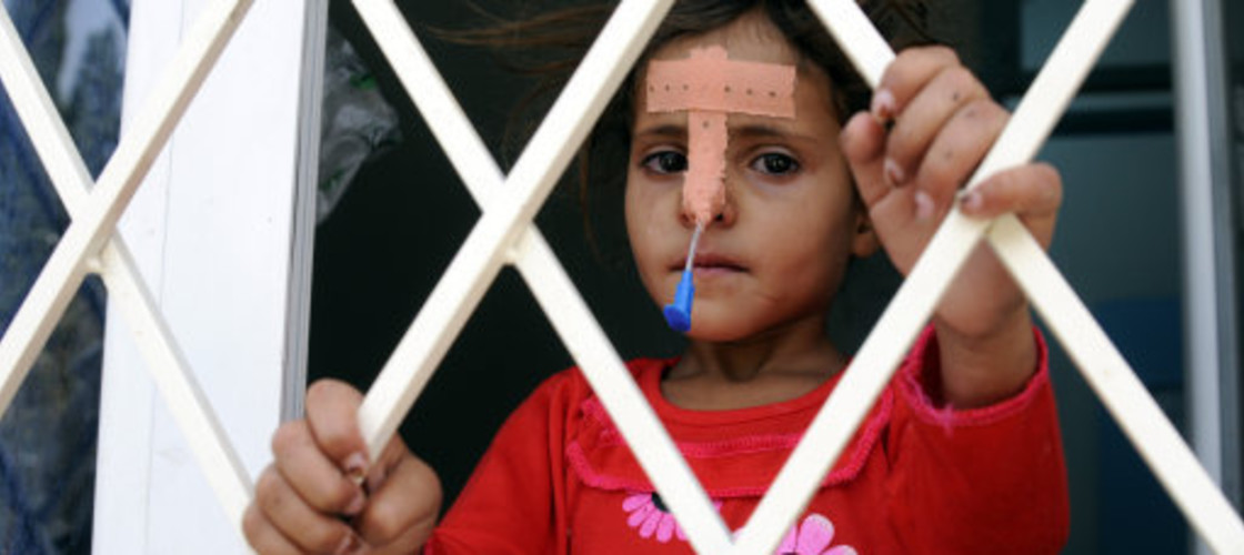 A cholera infected girl looks out of a window in Yemen