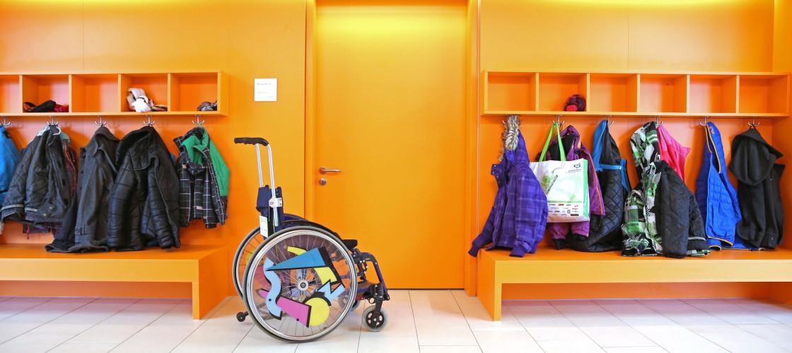 Wheelchair in school cloakroom