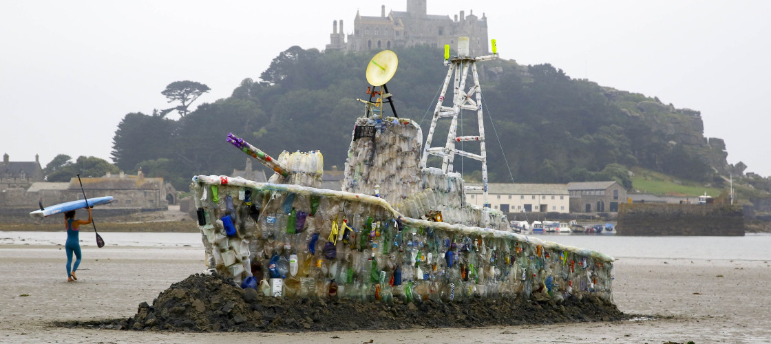A 30ft model of a warship, which is made entirely of plastic marine litter is unveiled on Marazion Beach in Cornwall