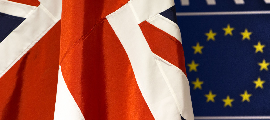 the EU stars and the Union Jack flag are next to each other at the European Parliament in Brussels