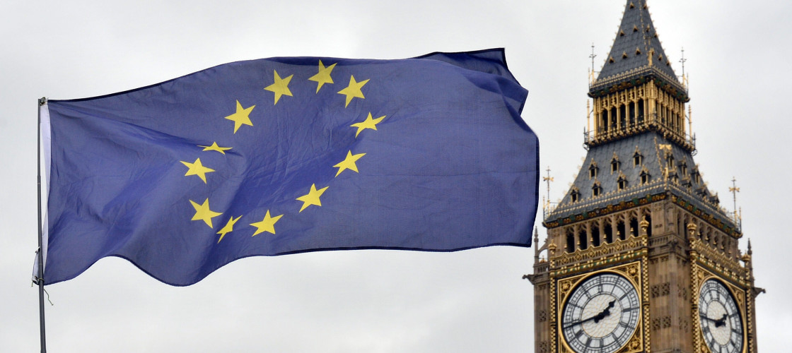 An EU flag flies in the foreground with the Elizabeth Tower in the background