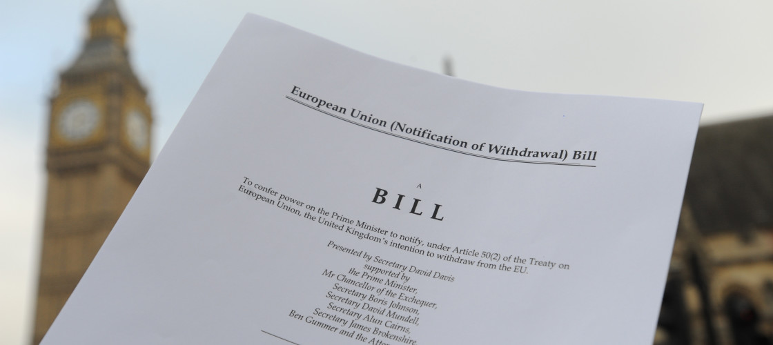 A copy of the EU Withdrawal Bill is held up in front of the Elizabeth Tower