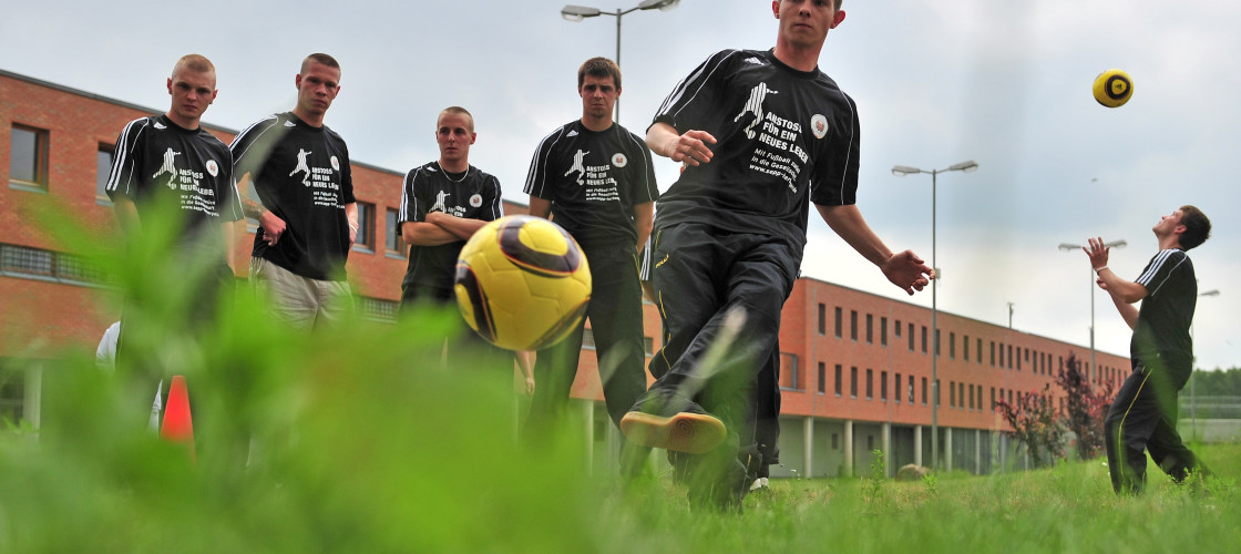 Young prisoners play soccer