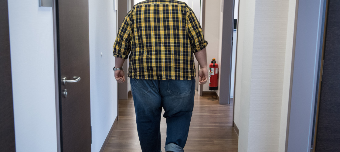 An overweight man attends a weight loss clinic