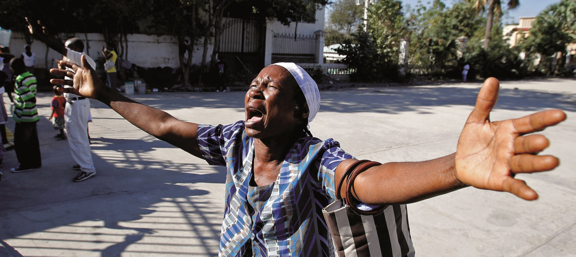A Haitian woman outside the earthquake damaged Notre Dame Cathedral, Port-au-Prince