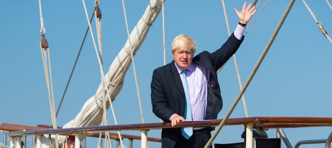 Boris Johnson waves from the deck of the tall ship Tenacious,