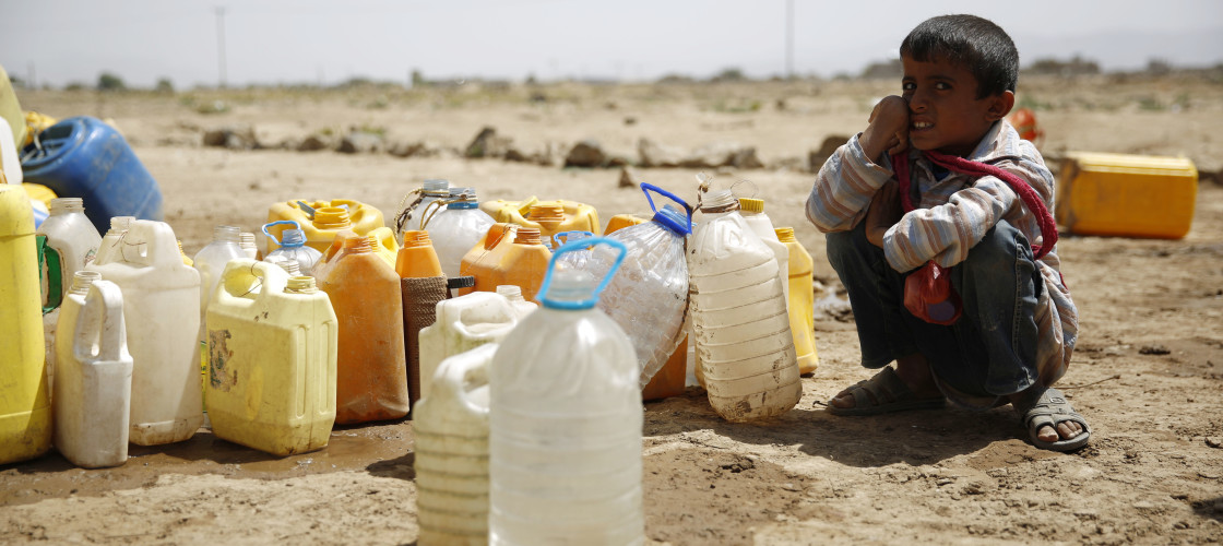 A boy waits for his turn to fill buckets with water from a public tap amid an acute shortage of water, on the outskirts of Sanaa, Yemen