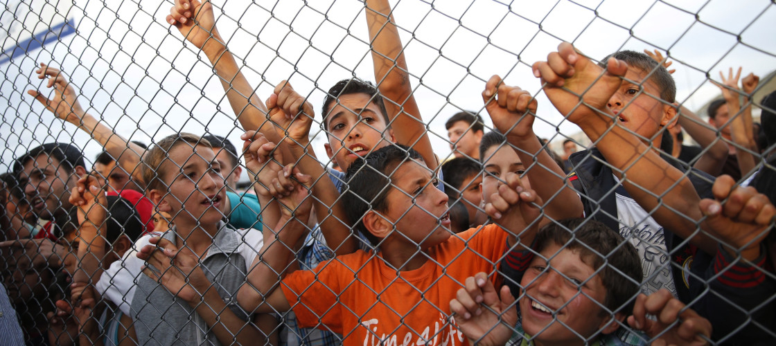 Syrian refugee children behind a fence at the Nizip refugee camp - Gaziantep province, southeastern Turkey