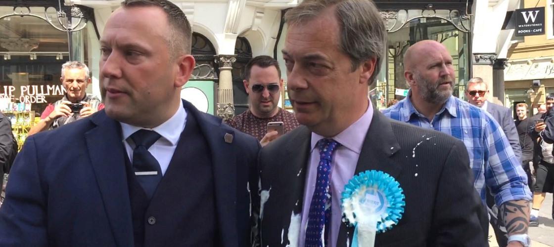 Nigel Farage with milkshake on his jacket