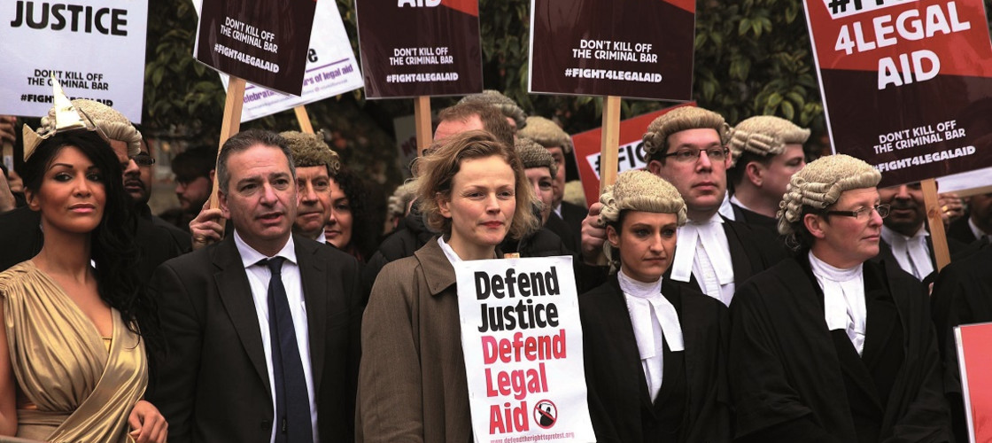 Protestors outside Westminster campaigning against legal aid cuts in 2014