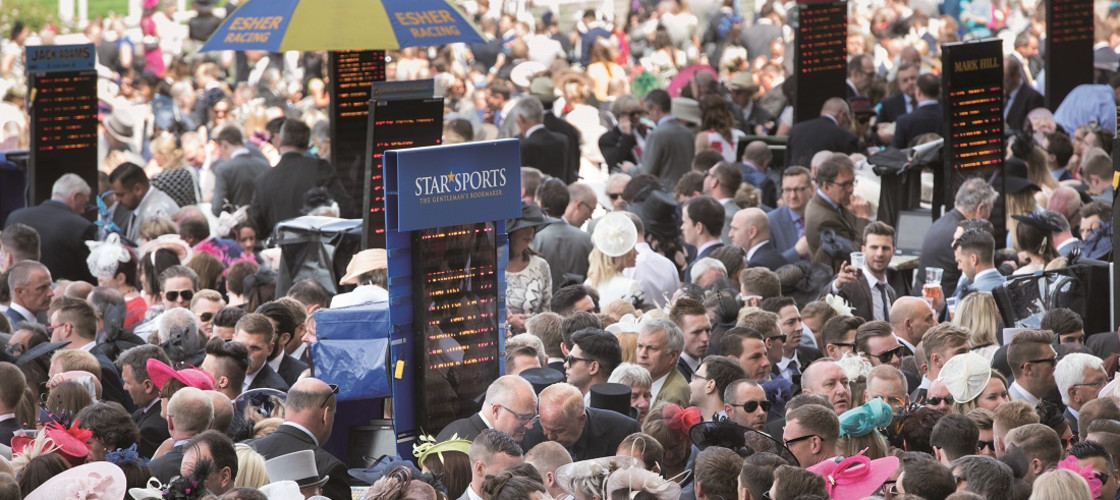 Racegoers place bets during day four of the 2015 Royal Ascot Meeting at Ascot Racecourse, Berkshire.