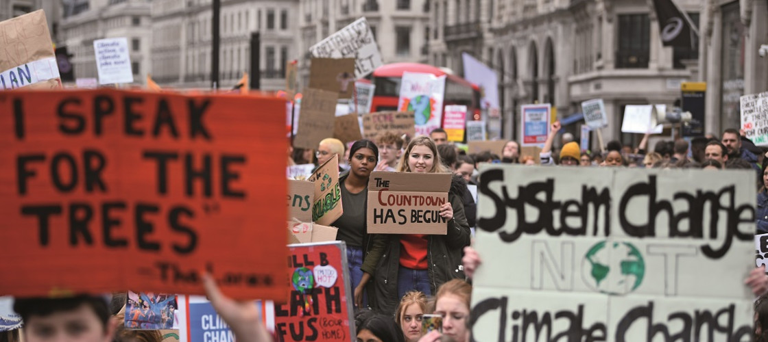 UK students take part in a strike for the climate crisis outside Parliament Square