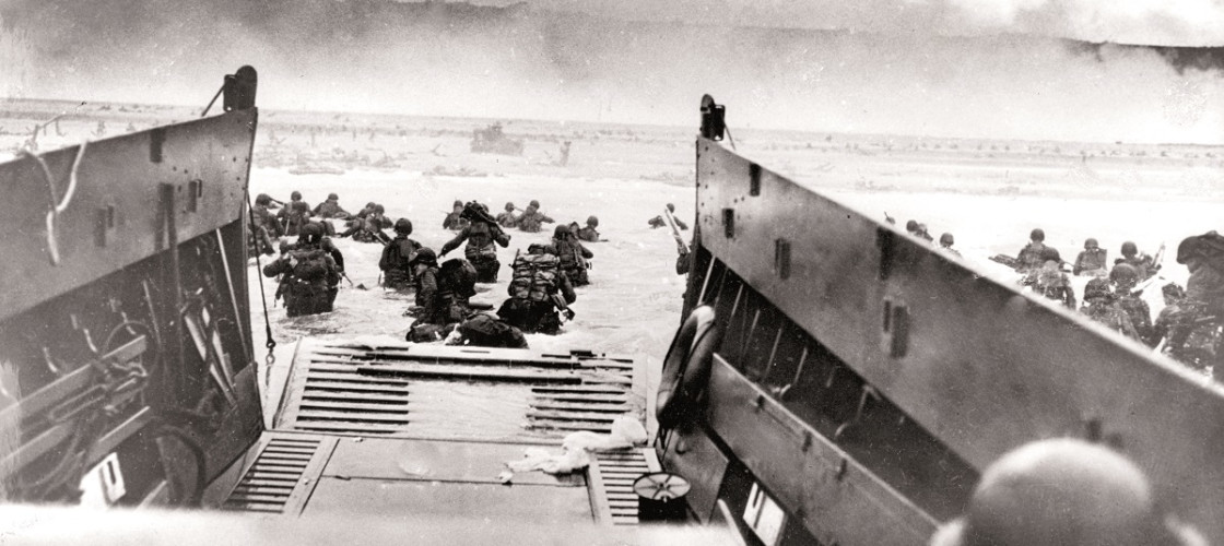 troops wading ashore from a landing craft during the D-Day invasion of France on 6th June 1944