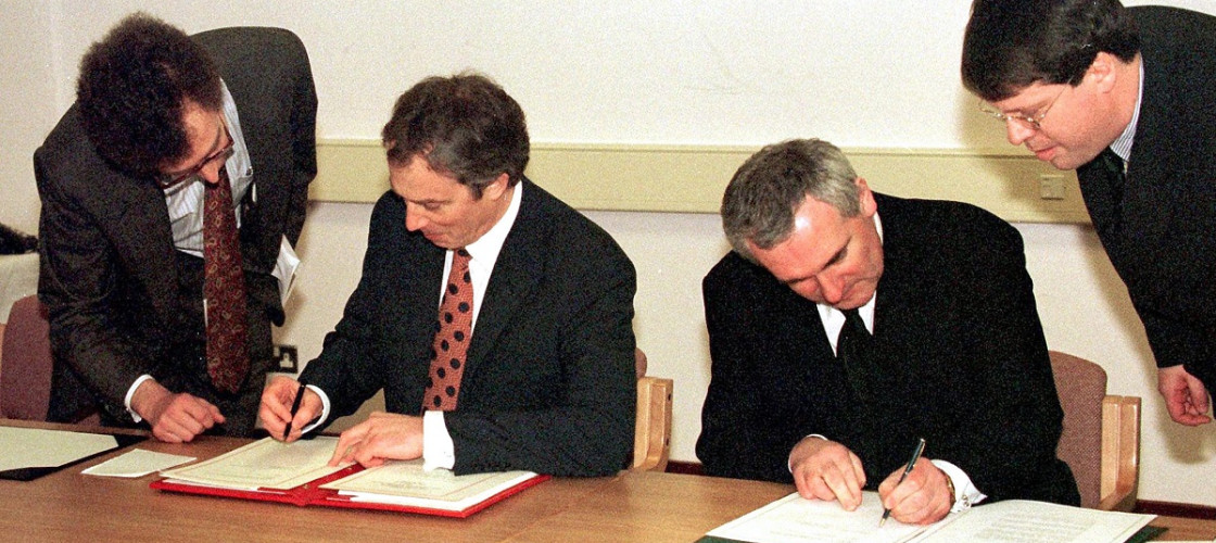 Former British Prime Minister, Tony Blair and Irish Taoiseach Bertie Ahern signing The Northern Ireland Peace Agreement in 1998