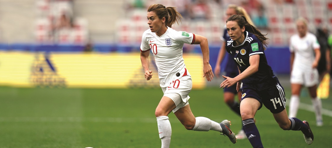 England's Karen Carney and Scotland's Chloe Arthur battle for the ball in the Fifa Women's World Cup