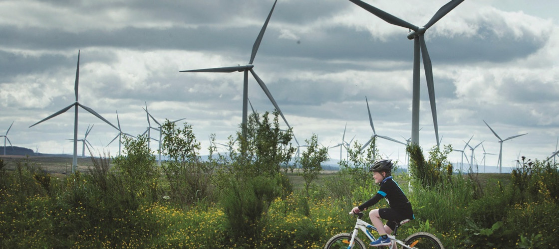 A child rides a bike at Whitelee Windfarm in East Renfrewshire, the UK's largest onshore wind farm
