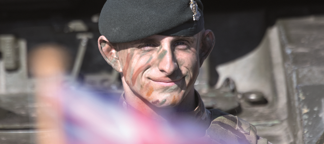 Soldier in camouflage paint