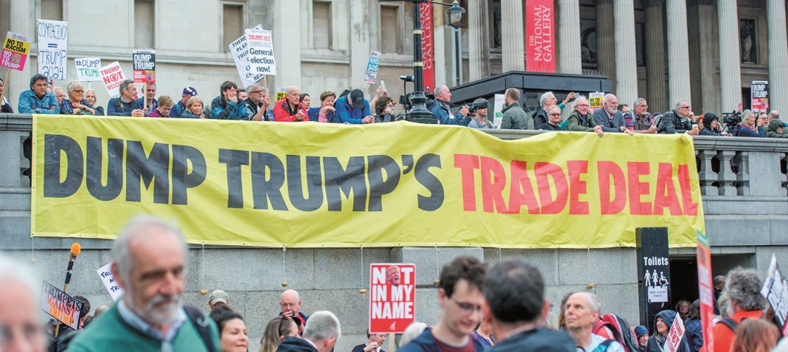 June 4, 2019 - Donald Trump protestors with a Dump Trump's Trade Deal banner at Trafalgar Square
