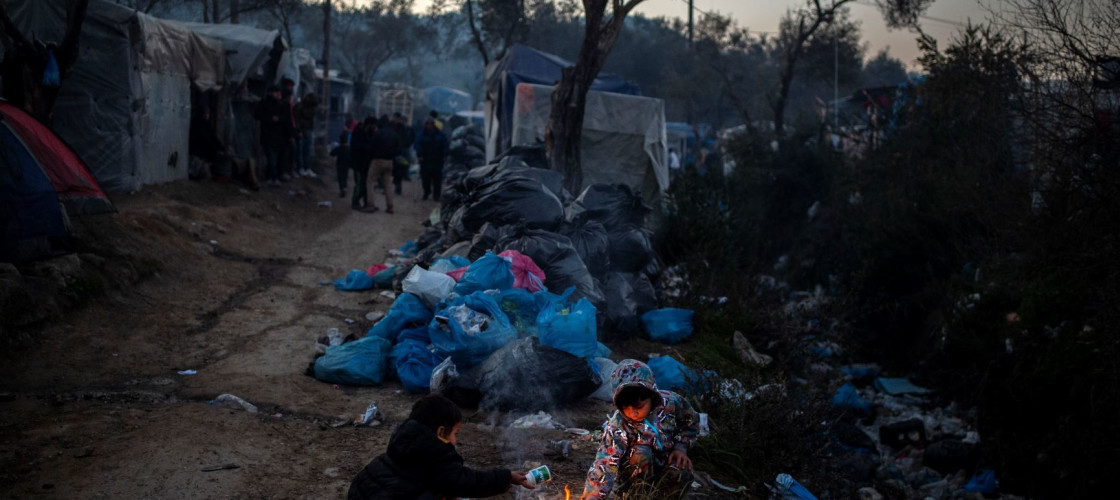 Children play on the grounds of a makeshift camp near the Moria refugee camp.