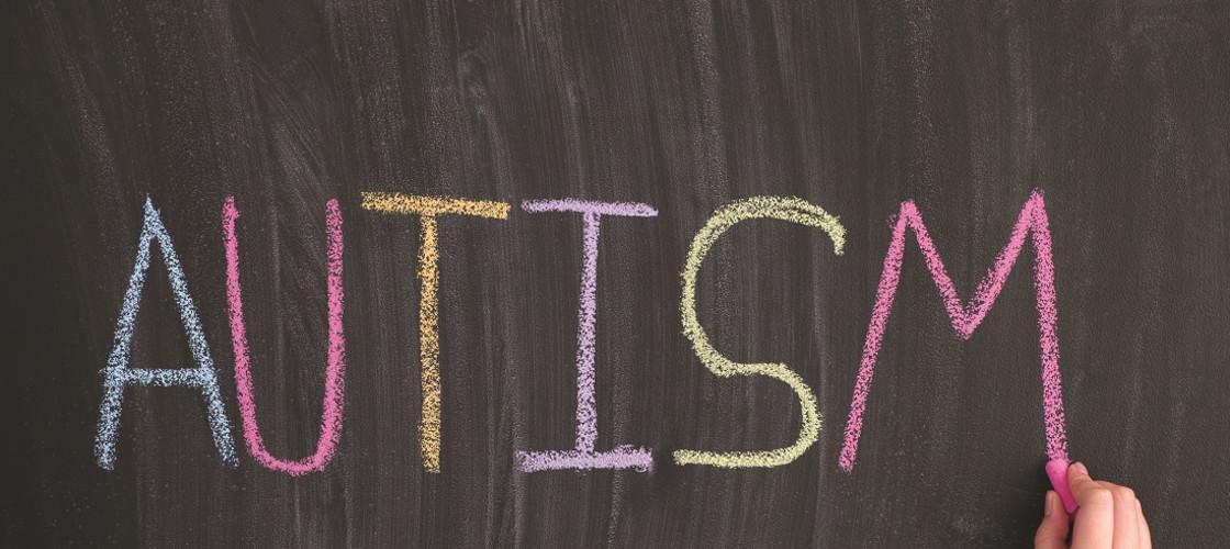 The word 'autism' written on a blackboard