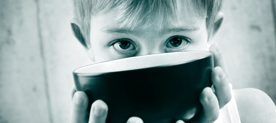 Child offering empty bowl