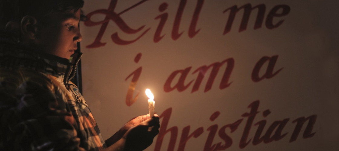 Pakistani activists from the 'Christian Helpline Pakistan' hold candlelight rally