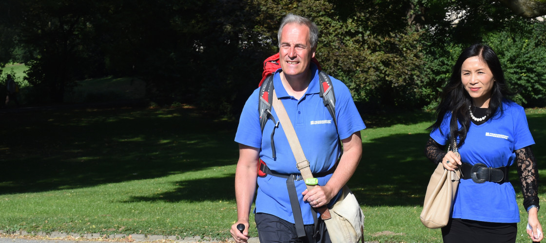 Lord Michael Bates hikes through Maschpark with his wife Xuelin