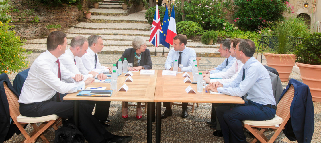 Theresa May and advisers hold talks with French President Emanuel Macron