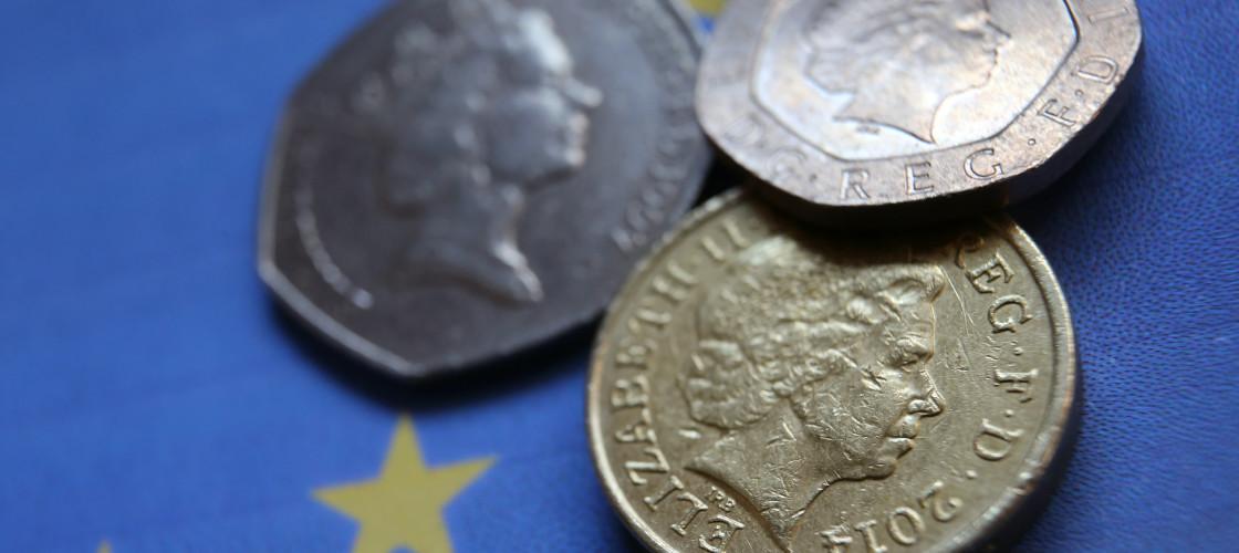 British coins on a European Union flag