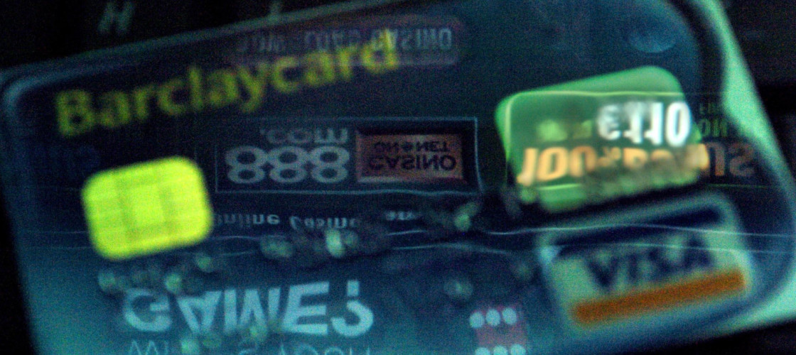 An online gambling site reflected on a credit card.