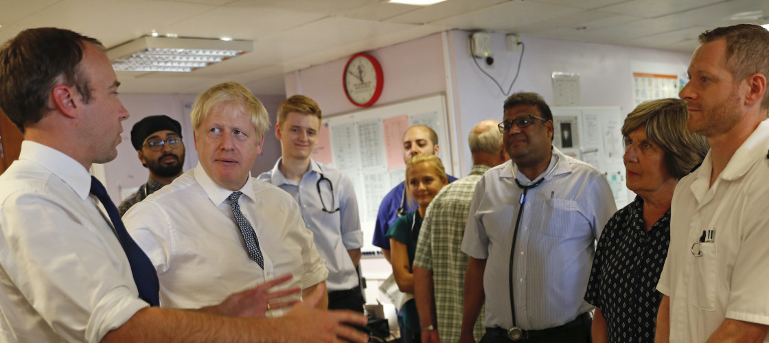Matt Hancock and Boris Johnson visit an NHS hospital.