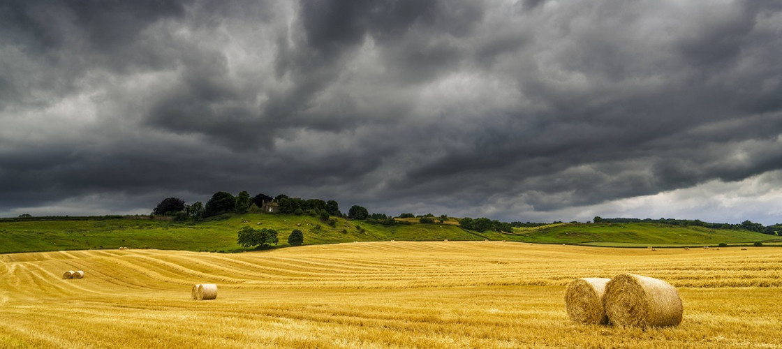 A picture of a farm in a storm
