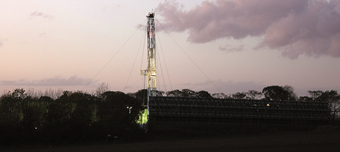 Shale gas rig lit up at night