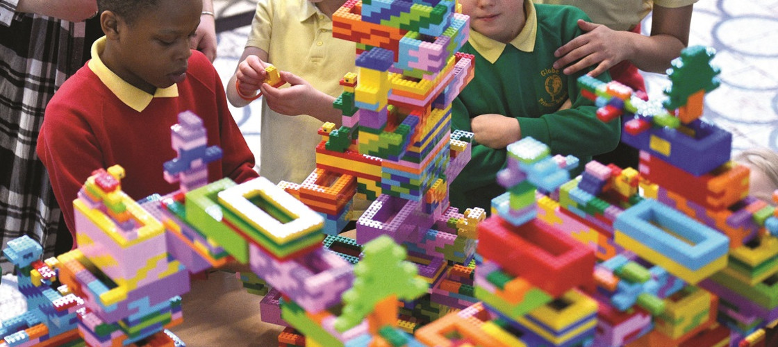 Pupils from the Globe Primary School build a Lego sculpture at the V&A Museum of Childhood in London