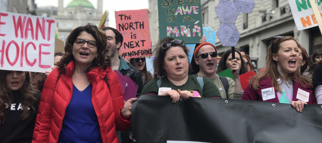 Diana Johnson MP and abortion rights campaigners march in the London 2019 St Patrick's Day Parade holding pro-choice banners