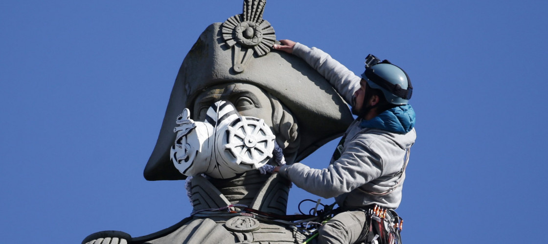A mask on the statue of Lord Nelson