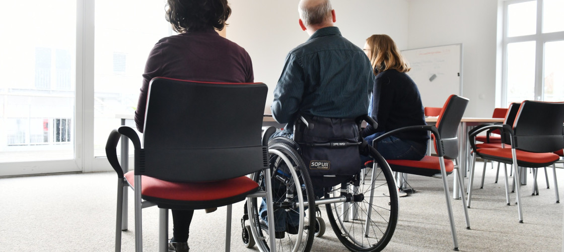 A wheelchair user at his workplace