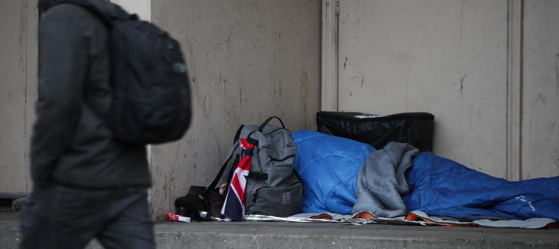 Person sleeping rough in a doorway