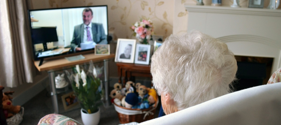 Elderly person watching TV