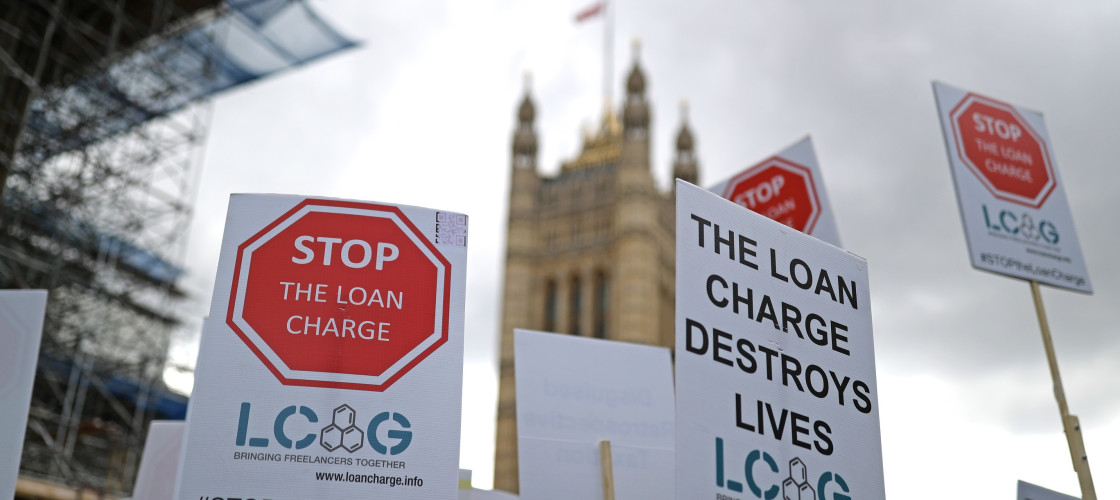 A loan charge protest outside the Houses of Parliament in Westminster, London