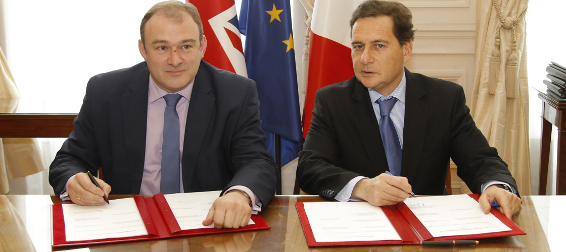 Former Energy Secretary Ed Davey signs an bilateral protocol agreement for non-military nuclear safety during a Franco-British summit at the Elysee Palace in Paris, 2012.