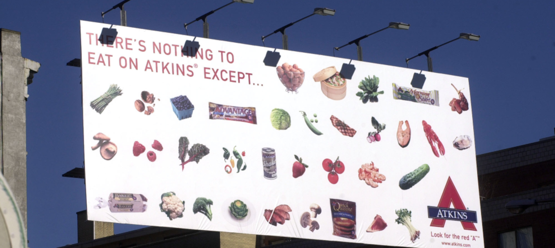 A billboard touting all the various foods you can eat while on the Atkins Diet