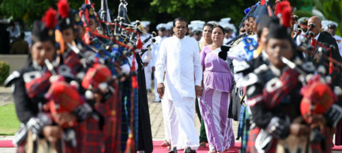 Sri Lankan President Maithripala Sirisena (Front C) arrives during a commemorative ceremony marking the 9th anniversary of the end of the island's civil war