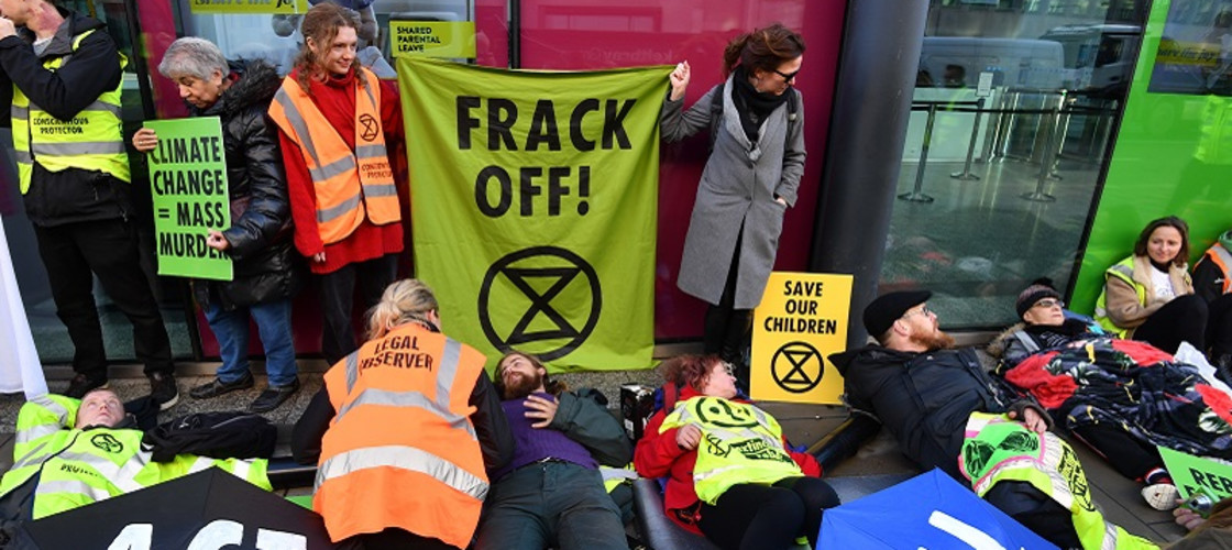 Anti-fracking protesters gather outside the BEIS Department building in London