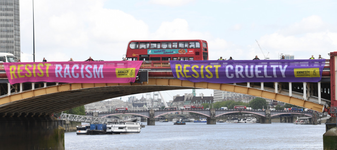 Amnesty International banners hang from Vauxhall Bridge in London