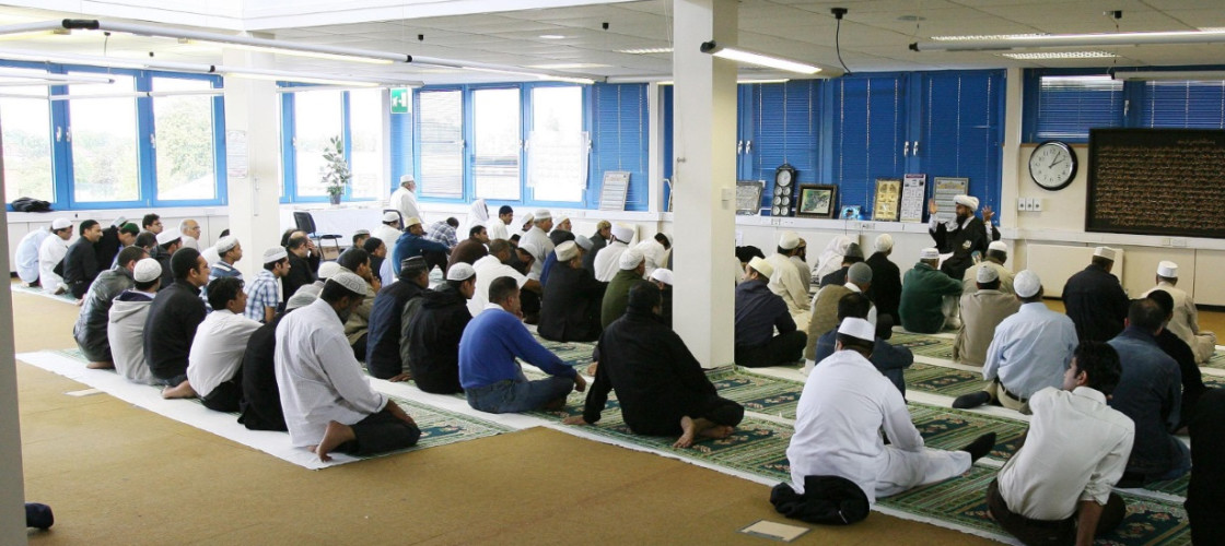 Muslims pray in Technor House, which is being used as a Mosque by local Muslims and is next to the Medina Dairy in Windsor, Berkshire