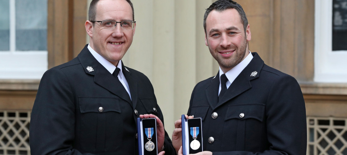 West Yorkshire Police Constables Craig Nicholls (left) and Jonathan Wright after they were awarded The Queen's Gallantry Medal by the Prince of Wales during an Investiture ceremony at Buckingham Palace, London, for arresting MP Jo Cox's murderer.