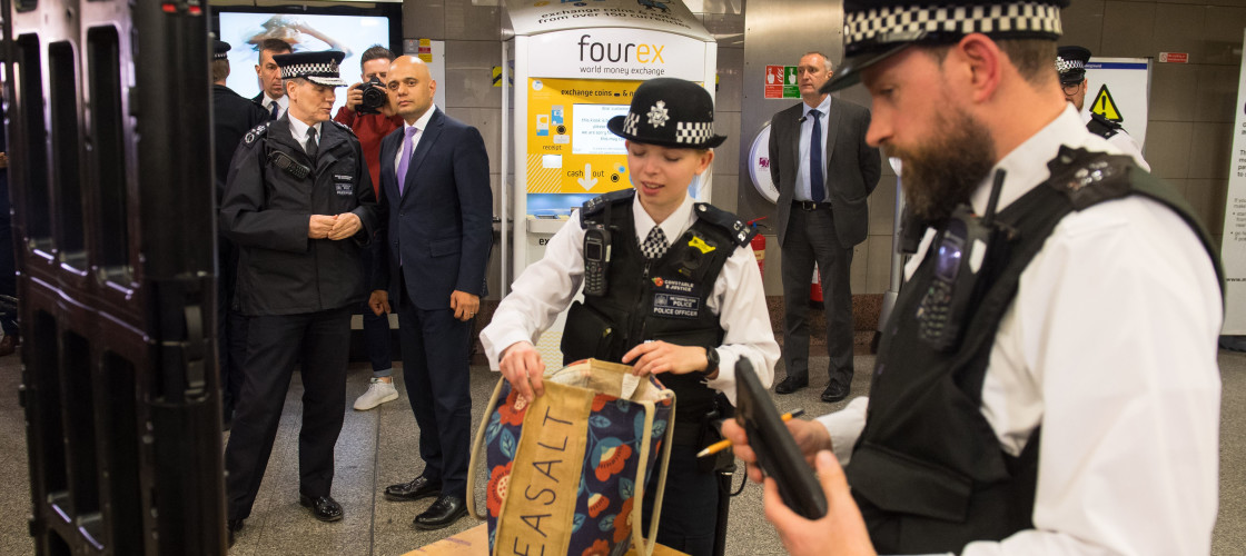 Home Secretary Sajid Javid and Metropolitan Police Deputy Commissioner Steve House, observe a bag search during a visit to Angel underground station to announce plans to allow more police officers enhanced stop and search powers as part of continued actio