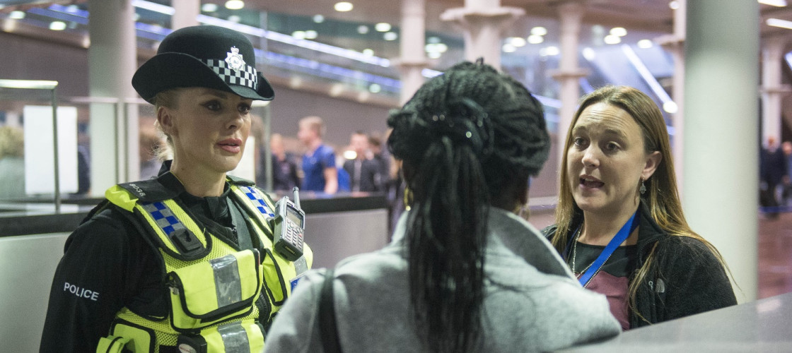 Metropolitan Police Constable talks to a woman
